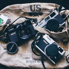 This trio of Canonet QL17 GIII's are a lovely sight indeed. Compact, with a fast lens, a variety of metering options and well built, they established a legacy that arguably lives on in todays compact cameras. I also think they look particularly good in black! Photo by @dvl #cameracult #canon #canonet #canonetql17 #ql17giii #film #35mm #rangefinder #ilford #filmcamera #filmrangefinder #cameraporn #compactcamera #shootfilm #filmisnotdead