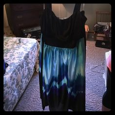 Fancy Dress Worn once as an Easter dress. It is black ontop then goes down to an ombré effect with blues. Has black ties on side to tie in back to make a bow. Hits at knees. I paired with a cap sleeve little cover for shoulders and it was gorgeous. Dresses Midi
