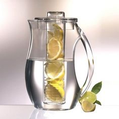 """Prodyne Natural Fruit Flavor Pitcher: Special thanks to Kiersti Pilon for sharing this one! This crystal clear acrylic pitcher has a removable fruit infusion rod that screws into the lid. The open slots in the rod allow liquid and fruit to mix naturally. Fill the rod with cut lemons, limes, raspberries, or any other fruit you desire. Pitcher may be continually refilled without having to replace the fruit. Now you can make all the """"spa water"""" you want--it's super easy!"""