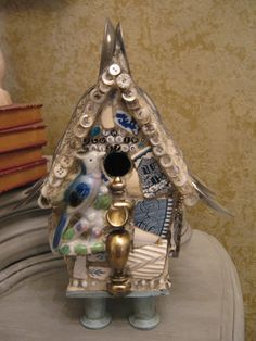The Bluebird Bistro - mosaic birdhouse in blues with spoons for the roof, buttons and mosaic art.