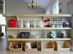 DIY organizing idea: Homemade kitchen shelving and wooden crate organizers underneath a bar/island. The thinner shelves might be an option for under our bar?