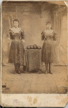 Amy Matchett and her sister Polly posing beside the tools of their trade - boxing gloves This was about 1890 and they were boxers on the family sideshow which travelled Scotland and the north of England.