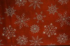 Cookie Cutter Christmas Snowflakes (Red background); sold by the yard