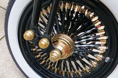 gold hub and nips with black twista spokes on 16 inch rims