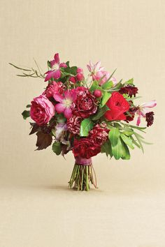 Perfect for a black-tie affair: garden roses, clematis, scabiosa, gomphrena, and eucalyptus and 'Mona Lavender' plectanthus foliage. are bundled with a deep purple silk moire ribbon.    Love It? Get It!Elizabeth Lewis Floral Design