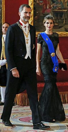 Looking good: Queen Letizia looked wonderful in her striking black lace gown and diamond tiara and dapper King Felipe looked equally good in his evening ensemble as they attend Gala dinner at the Royal Palace on 29.10.2014 in Madrid