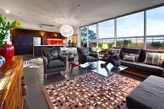 Beautiful decor - stunning rug, lighting, armchairs and coffee table sculpture.    FITZROY NORTH, 409 & 410/4 Bik Lane    Nelson Alexander Real Estate  Melbourne, Australia