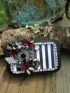 Hey, I found this really awesome Etsy listing at https://www.etsy.com/listing/524789192/altered-altoid-tin-vintage-jeweled-tin