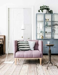 Muted hints of colour and natural  wooden flooring = calm