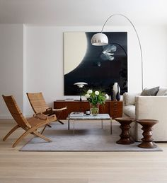 Hans J. Wegner folding chairs, Poul Kjaerholm table with marble top, Poul Henningsen table lamp and Arco floor lamp by Achille & Pier Gi...