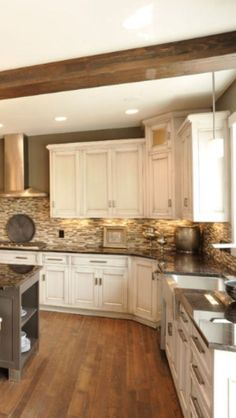 Our kitchen would look similar with the painted cream cabinets,dark floor, same colors for backsplash To-ceiling cabinets. Wood floor. Backsplash w/undercounter lighting. Like a warm Farmhouse Style #Kitchen #Farmhouse #PaintedCabinets