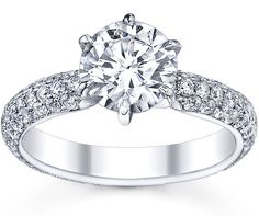 this pave diamond engagement ring is a more modern version of a solitaire engagement ring.