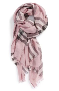 Crushing over this pastel pink, off white and black Burberry scarf. It's the perfect little pop of color.