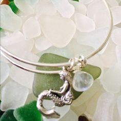 New ! Mermaid & Moonstone  New ! Genuine Moonstone and Silver Mermaid charm dangle side by side on a silver expandable bangle. ( similar to Alex & Ani Style ) Comes in a shimmering organza jewelry w, gift wrapped and shipped in a box. Price is firm unless bundled. My closet discount is 10% off any 2 or more items ! Alex & Ani Jewelry Bracelets
