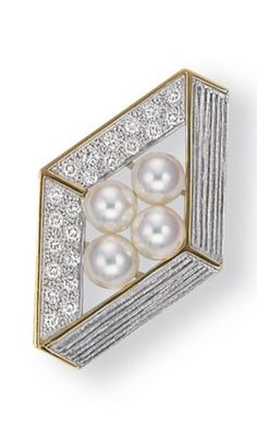 A CULTURED PEARL AND DIAMOND OBI CLASP, BY MIKIMOTO The clasp centering upon a cluster of cultured pearls, within a pavé-set diamond or textured gold lozenge-shaped openwork plaque, mounted in 14k and 18k white gold, 4.3 cm wide With jeweller's mark for Mikimoto