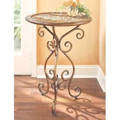 Luccan Embossed Round Table With Woodtrim. Iron And Wood for only $104.38 #shoplocal #livelocal #shopping #nyc