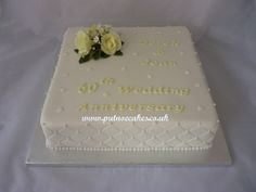 Lemon and white classically styled diamond wedding anniversary cake