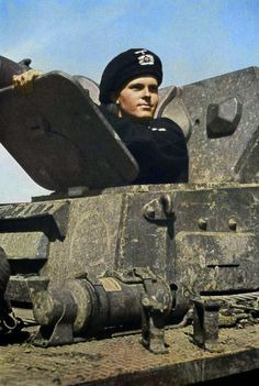 "Early war photo of German Panzerkampfwagen IV Ausf.C or D (Sd.Kfz. 161) driver wearing the beret-type ""Schutzmütze"" (protective cap)."