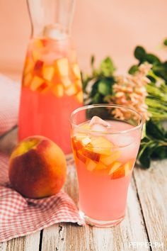 Pink Peach Lemonade...1 liter prepared pink lemonade  2 peaches, seeded and cubed  1/4 cup peach vodka  1 cup ice cubes