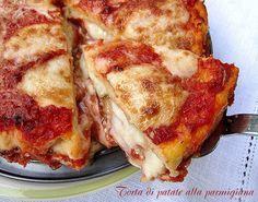 Non c'è niente da fare, la giusta fine delle melanzane è una buona Parmigiana! Oggi però la Parmigiana l'ho messa dentro ad un involucro di patate .........