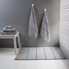 Drop bath towels and path rugs. Part of our Urban Explorer bath concpet with different shapes, different lines and mainly warm dark tones that never disappoint or compromise.