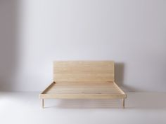 Solid Ash bed frame with brass hardware details. Making use of simple woodworking techniques, theSimple Collectionoffers purity of material, form and function.