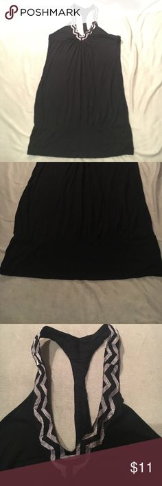 Long black tank Long black tank with banded bottom with Aztec neck design. Gently worn Charlotte Russe Tops Tank Tops