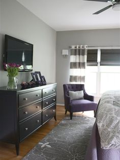 , Attractive Contemporary Bedroom Ideas For Couples Also Black Wooden Chest Of Drawers Also Light Grey Wall Paint Color And Brown Laminate Floor Also Elegant Purple Armchair Also Grey Carpet And White Grey Curtain: The Best and Lovely Bedroom Ideas for Couples