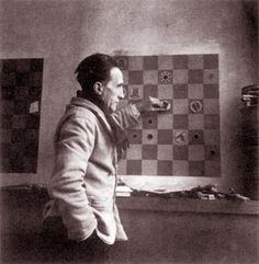 Duchamp.  The  board has got 64 squares - and you can see the Rook in c6 and a bishop (?) in f3! But what are the other pieces? - The artist has invented new ones?