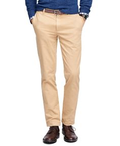 """<a href=""""#pdplearnmore"""" class=""""lm"""">The Red Fleece Collection</a><br>These chinos are crafted from cotton with a touch of elastane for added stretch and comfort. This modern fit has a low rise and narrower fit in the leg, knee, and leg opening.  Gingham oxford lines the front pockets and the back  pockets have a stripe lining. Machine wash. Imported."""