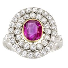 1900s edwardian platinum over 18ky gold with ruby and old european cut diamond oval cluster ring