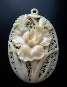 "Carved ivory ""Iris"" pendant, Victorian."