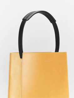 """Our Tapered Tote is a simple, minimalistic structured bag. It's clean, angular lines give this bag a stand-out sophisticated look. Large enough to fit a 13-15"""" laptop and everyday work essentials, with the added extra of a secure internal pocket."""