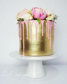 36 Drip Wedding Cakes Almost Too Pretty To Eat. Gold and pink drip cake. #dripcake  See more at http://www.theweddingguru.ca/36-drip-wedding-cakes-almost-too-pretty-to-eat/