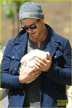 This is Chris Hemsworth a.k.a. Thor holding his baby girl. There is nothing I don't love about this. A) hot man B) tiny little baby C) the baby blanket has little ears D) there is nothing better than a man with a baby (not in a creepy pedophile way).