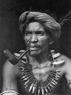 Respected elder Lakay Kabayo, wearing his Buaya (ceremonial necklace) with boar, dog and crocodile teeth in woven rattan.  Sagada, Mountain Province 1950 (Credit - World Press.Photo)
