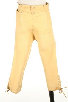 Pair of breeches, c. 1790. Doeskin, with self covered buttons, fall-front with three pockets.