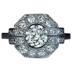 French Art Deco Diamond Platinum Ring 1920s. Centered with an antique cushion cut diamond (5.3 x 4.8 x 3.4 mm, approximately 0.73 ct) framed by transitional, old mine and old single cut diamonds, estimated total diamond weight 1.18 ct.  Marked with a dog's head French platinum mark and maker's mark. France, 1920s