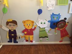 Our Daniel Tiger party: handmade cutouts of the DT gang using a ton of 12x12 scrapbooking paper.