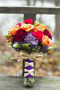 Rustic Green Orange and Ivory Autumn Wedding   Confetti Daydreams - and note the dramatic effect of ribbon and raffia on the handle - that's Smart... and Smashing!