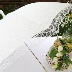 So if we end up outside... So cute! If it rains we'll take cute outdoor pics! lace victorian wedding umbrella by the brolly shop | notonthehighstreet.com