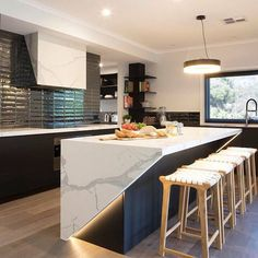 This modern black and white kitchen has a engineered terrazzo counter called Statuario Grey. This material is thick and can be placed on top if existing countertops. There are many colors and styles available. Kitchen Bar Design, Luxury Kitchen Design, Kitchen Layout, Interior Design Kitchen, Bar Counter Design, Kitchen Ideas, Modern Kitchen Interiors, Contemporary Kitchen Cabinets, Kitchen Modular
