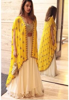 60 GM Georgette Party Wear Lehenga Choli In Cream and Yellow Colour Buy Best price latest designer Georgette Party Wear Lehenga Choli In Cream and Yellow Colour online in india Cash on Delivery Available! Indian Fashion Dresses, Indian Designer Outfits, Pakistani Dresses, Indian Dresses For Girls, Indian Inspired Fashion, Indian Fashion Modern, New Designer Dresses, Pakistani Fashion Casual, Indian Fashion Trends