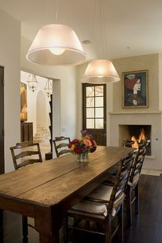 Classy and Cool Dining Room Farmhouse style.  Love this whole space including fireplace and art piece.