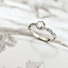 Stunning platinum & diamond engagement ring with floral band from Rust Jewelry.