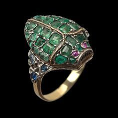 ✨✨ This 19th century emerald-studded #scarab ring is a #beautifulbug that's practical, too! A secret chamber inside the bug holds a hinged #vinaigrette screen. The gold, open-worked and foliate screen lifts up so that the wearer may insert a piece of fabric saturated with vinegar or scented oils. (Back in the day, when horses were the main form of transport and streets stank of garbage, vinaigrette rings helped women gracefully endure, in style.) For sale by venerable Auckland, New Zealand…