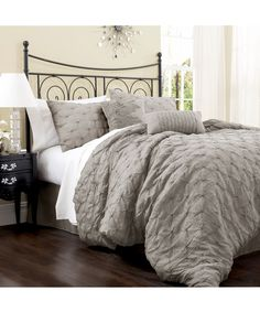 Gray Lake Como Comforter Set. I need a masculine set for the guest room. This is it I think. And that's our bed... lol It works...