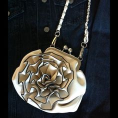 ⚡️NWTWhite Flower Kiss Cross Body Purse So pretty! Dress up or dress down! Kiss closure, black trim, faux leather, interior slip pocket and an interior zip pocket. Silver hardware. Two straps - one long, one short. Blossom Bags Crossbody Bags