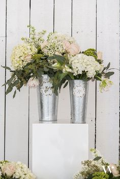 These delightful galvanized market buckets are ideal for creating elegant arrangements using long-stemmed flowers. The wood-accented handle adds a nice, natural detail and the cool, pewter grey of the bucket evokes an industrial vibe. Will complement a wide range of wedding themes.