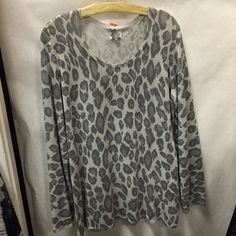 Chico's Animal Print Top Chico's long sleeve animal print top. It is a Chico's size 3 which in regular clothing sizes it fit a lovely of size 16-18.  Chico's is a well made brand and will continue to look amazing. Chico's Tops